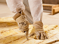 hands cutting insulation